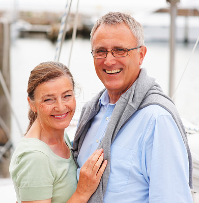 Buy stock photo Portrait of a happy old couple embracing on sailboat