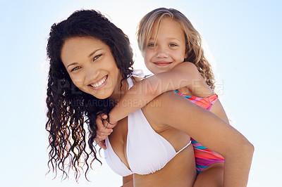 Buy stock photo A young mother piggybacking her daughter