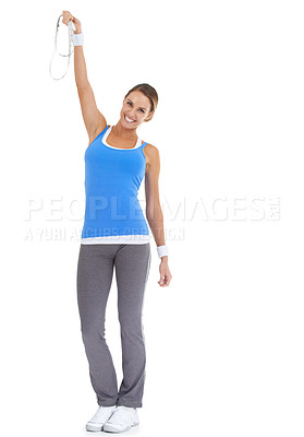 Buy stock photo Healthy young woman expressing triumph while holding a tape measure and isolated on white