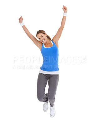 Buy stock photo Energetic young woman in sportswear jumping while isolated on white