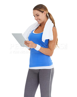 Buy stock photo Young woman in sportswear using a tablet while isolated on white