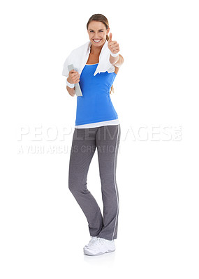 Buy stock photo Fit young woman giving you a thumb's up against a white background while holding a tablet