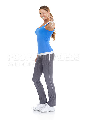 Buy stock photo Fit young woman giving you a thumb's up against a white background
