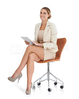 Buy stock photo A beautiful businesswoman sitting with a digital tablet against a white background