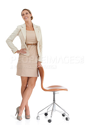Buy stock photo A beautiful businesswoman standing by an office chair - isolated
