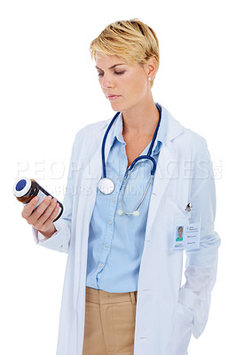 Buy stock photo A young female doctor holding a bottle of pills