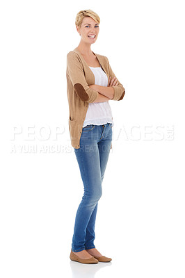 Buy stock photo Full length of a pretty young woman crossing her arms while isolated on a white background