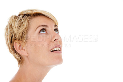 Buy stock photo A beautiful young woman looking up while isolated on a white background