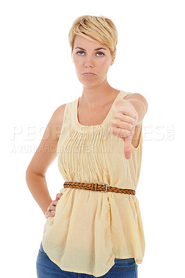 Buy stock photo A disappointed young woman giving you a thumbs down while isolated on a white background