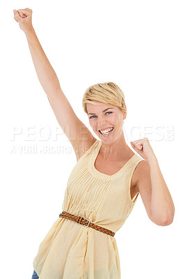 Buy stock photo An excited young woman celebrating while isolated on a white background