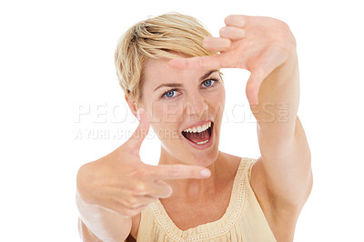 Buy stock photo An excited young woman framing you with her hands while isolated on a white background
