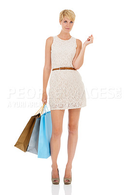Buy stock photo A pretty young woman carrying shopping bags while isolated on a white background
