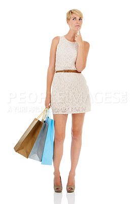 Buy stock photo A pretty young woman carrying shopping bags and looking thoughtful while isolated on a white background