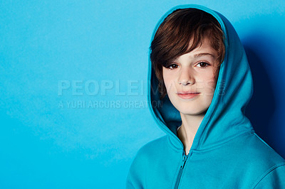 Buy stock photo Portrait of a young boy wearing a blue hoodie in the studio