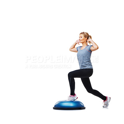 Buy stock photo An attractive young woman toning her thighs on a bosu-ball