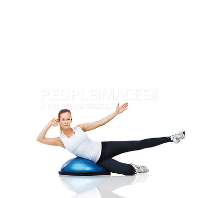 Buy stock photo Portrait of an attractive young woman lying on a bosu-ball while working out