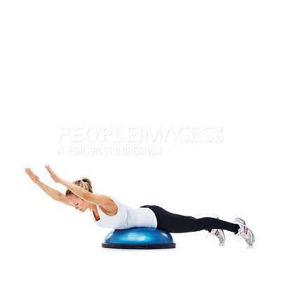Buy stock photo A young woman strengthening her core on a bosu-ball
