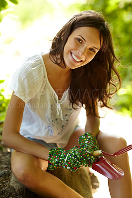 Buy stock photo Portrait of gorgeous young girl with rake and trowel sitting outdoor smiling