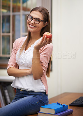 Buy stock photo A beautiful young teacher sitting in her office