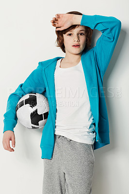 Buy stock photo Cute preteen boy holding a football while isolated on white