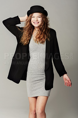 Buy stock photo Portrait of a hip young teenage girl standing against a gray background