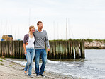 Happy young couple having a stroll on the sea shore