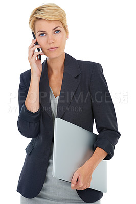 Buy stock photo A young businesswoman talking on her cellphone while carrying her laptop