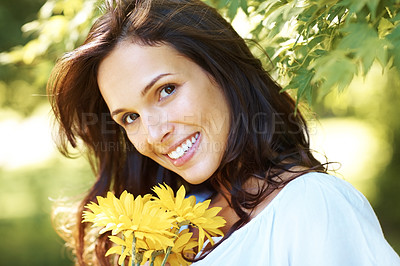 Buy stock photo Cropped shot of an attractive young woman in the park