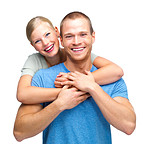 Happy young couple embracing over white