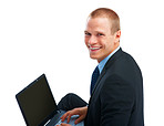 Smart young business man using a laptop, smiling over white