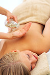 Young female getting an oil massage for her back