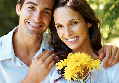 Buy stock photo Cropped shot of an affectionate young couple in the park