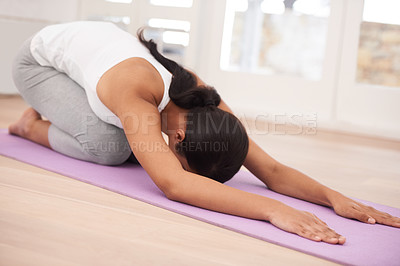 Buy stock photo A young woman exercising in her home