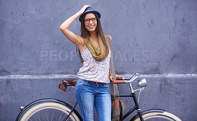 Buy stock photo A gorgeous young woman standing with her vintage bicycle