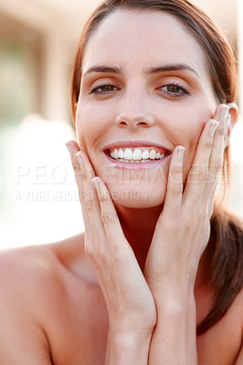 Buy stock photo Closeup of attrative young lady pampering her face