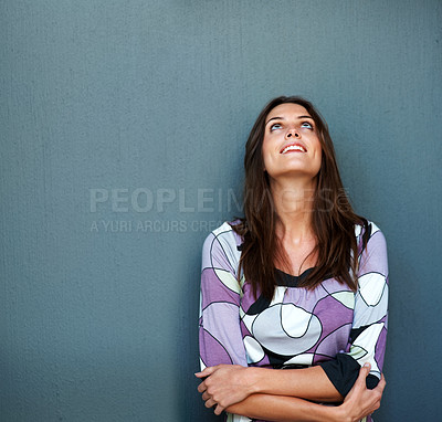 Buy stock photo Happy young woman looking up against grey backgrou
