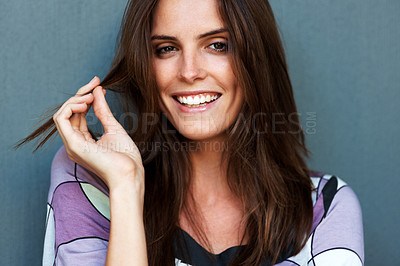 Buy stock photo Pretty young fashion model smiling over grey backg