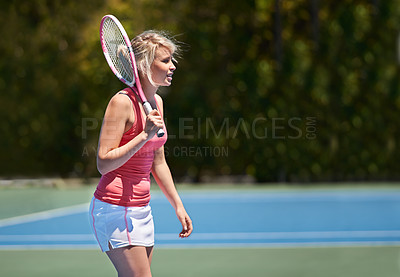 Buy stock photo A young tennis athlete in the middle of a set