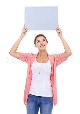 Buy stock photo A beautiful young woman holding a blank placard against a white background