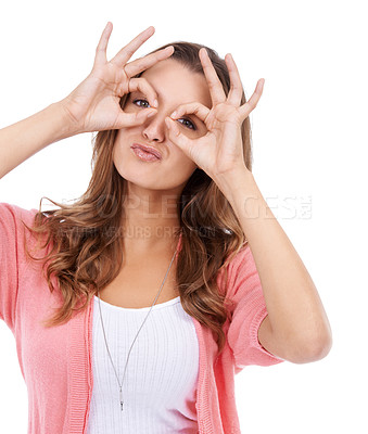 Buy stock photo A young woman posing playfully with her fingers in circles in front of her eyes