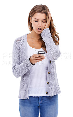 Buy stock photo Attractive young woman looking at her cellphone in disbelief