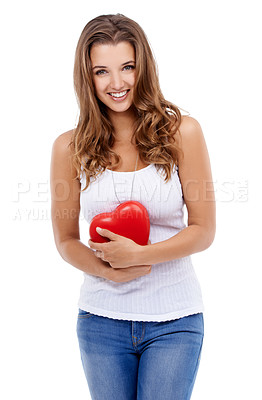 Buy stock photo Studio shot of an attractive young woman holding a small heart isolated on white