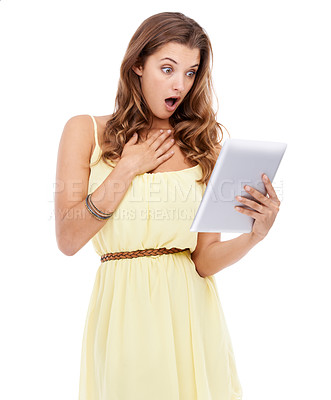 Buy stock photo Studio shot of a surprised looking young woman holding a digital tablet