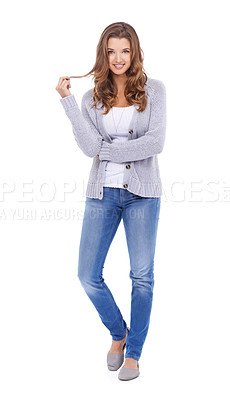 Buy stock photo A young woman in casual clothes standing and playing with her hair