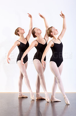 Buy stock photo Young girls during ballet class