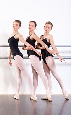 Buy stock photo Young girls in ballet class