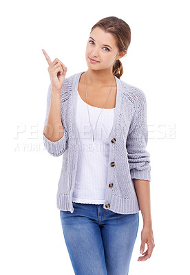 Buy stock photo A young woman pointing up at copyspace