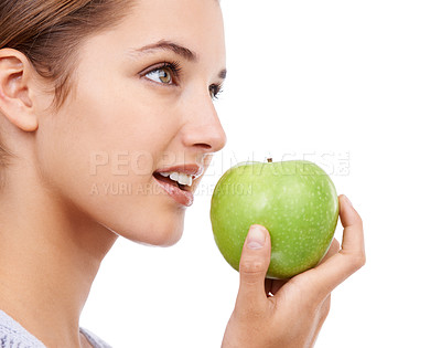 Buy stock photo A young woman holding an apple - isolated