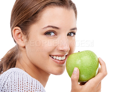 Buy stock photo A young beautiful woman holding a green apple