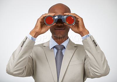 Buy stock photo Attractive young man standing and looking through binoculars